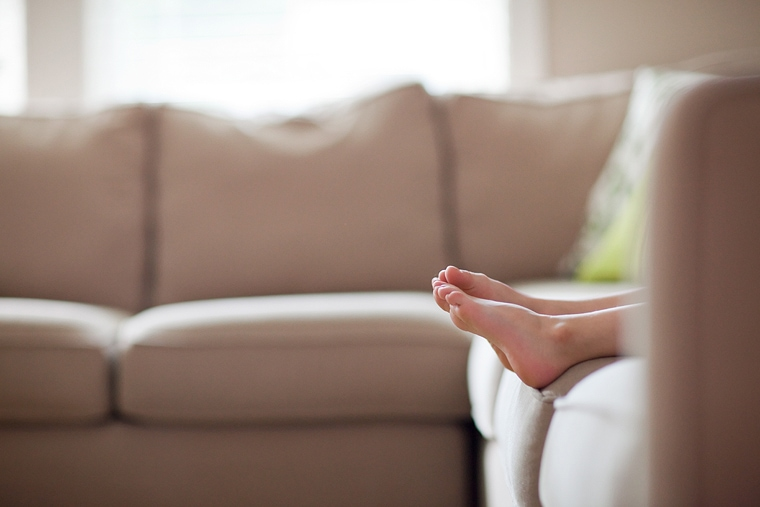 little feet on a couch