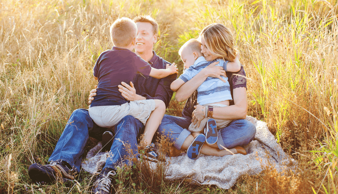 family photos cuddling in field