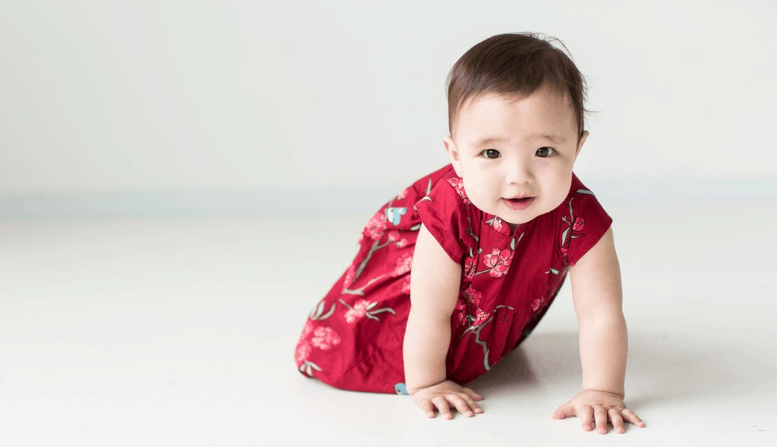 studio family portraits girl crawling