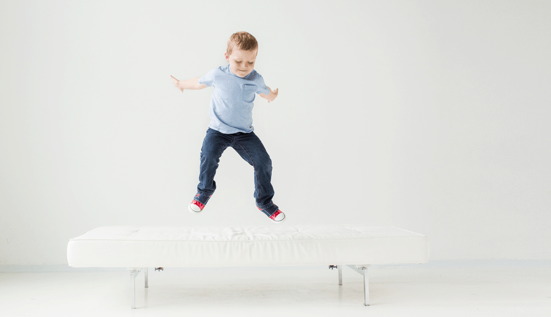 studio family portraits Vancouver boy jumping