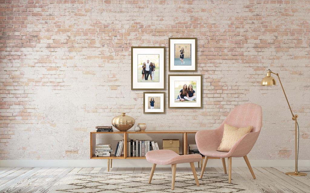 Jenn Di Spirito Photography session pricing | sample wall gallery with brick wall and 4 frames