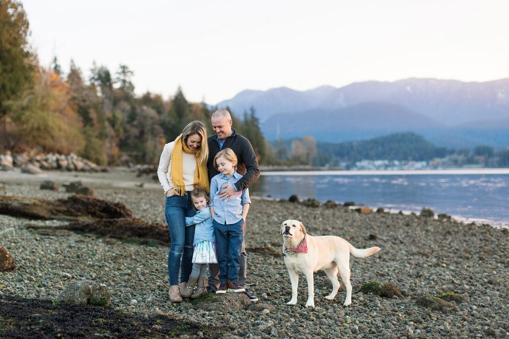 family of four on beach as an example of Vancouver family photographer locations recommendations